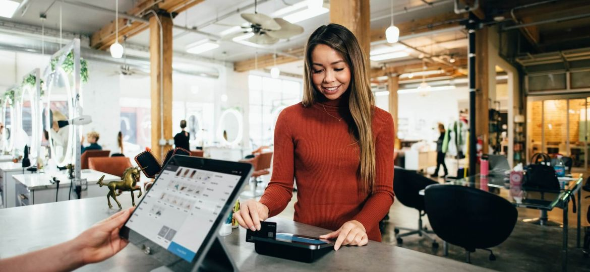 how prepaid credit cards work woman makes purchase