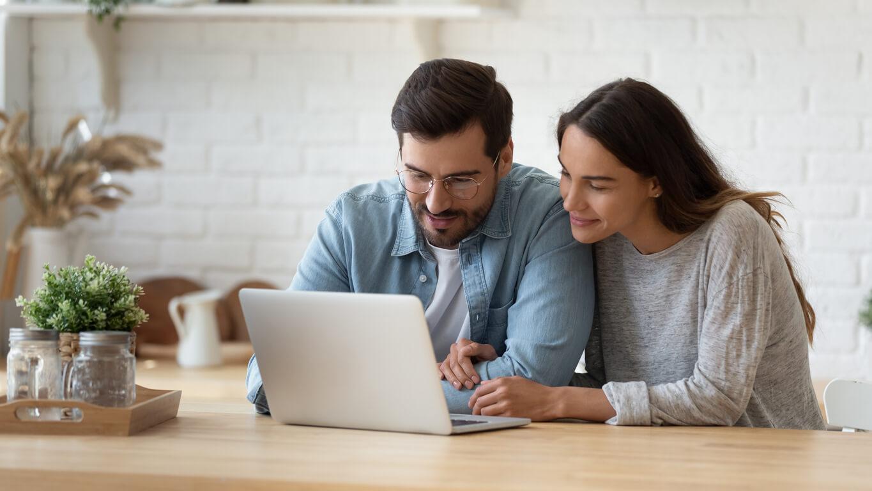 Couple contemplating loans online